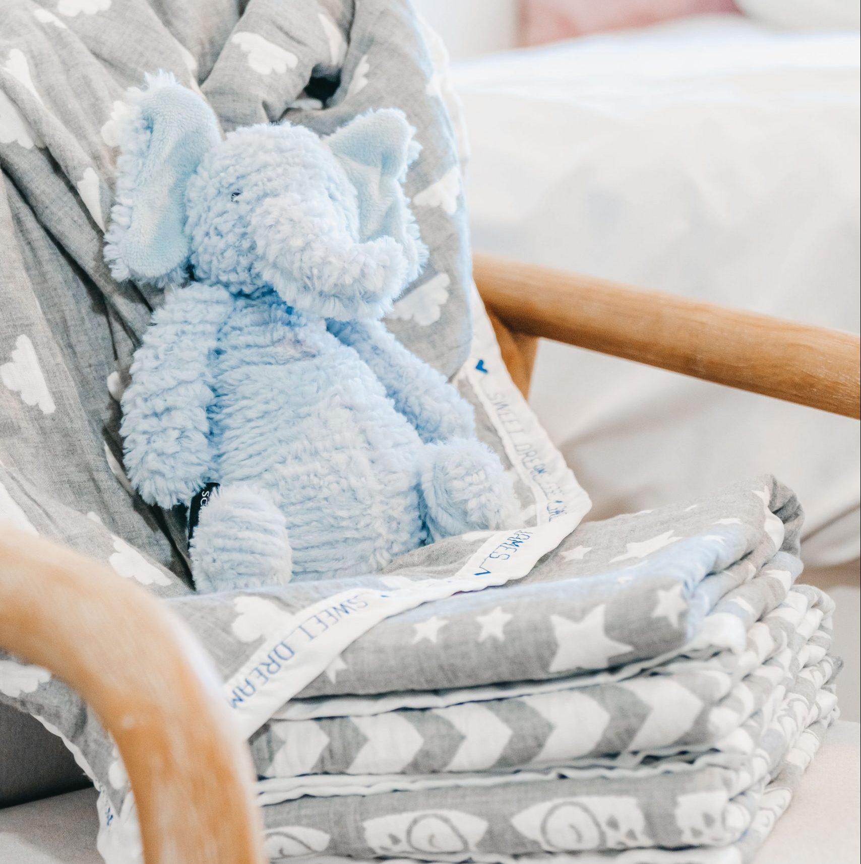 stuffed elephant toy on muslin stack custom blankets