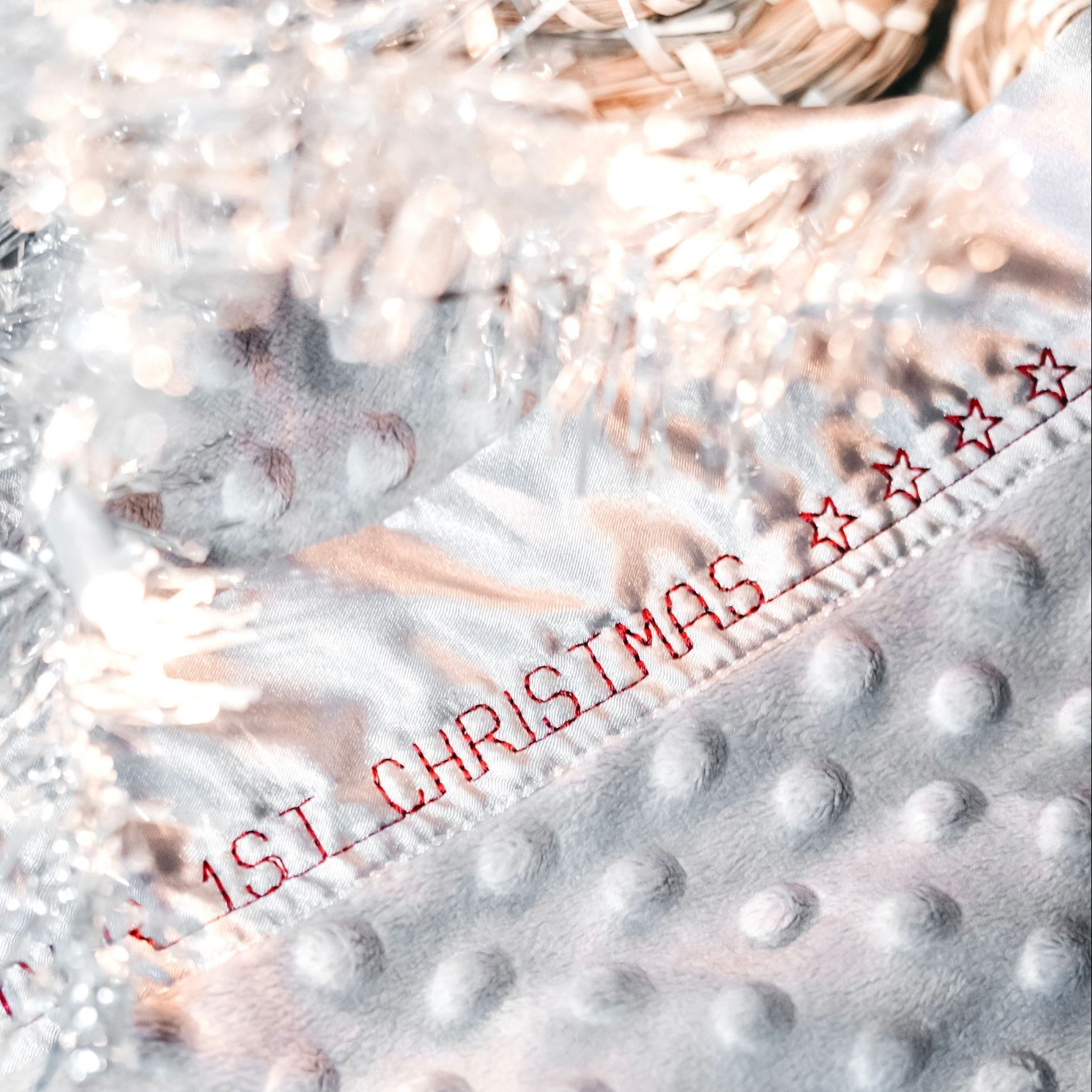 grey custom Christmas blanket under silver tree