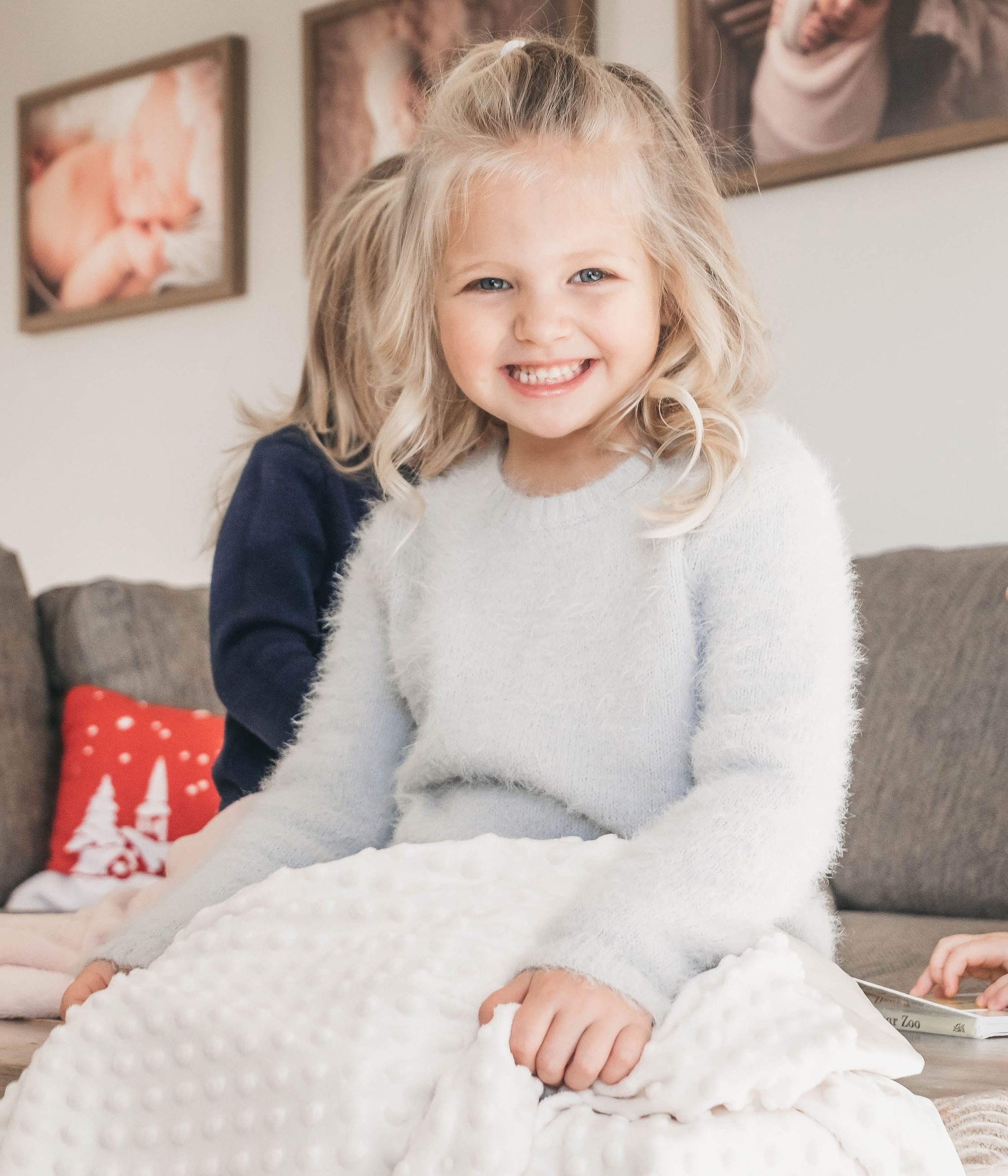 child holding minky dot personalized blanket
