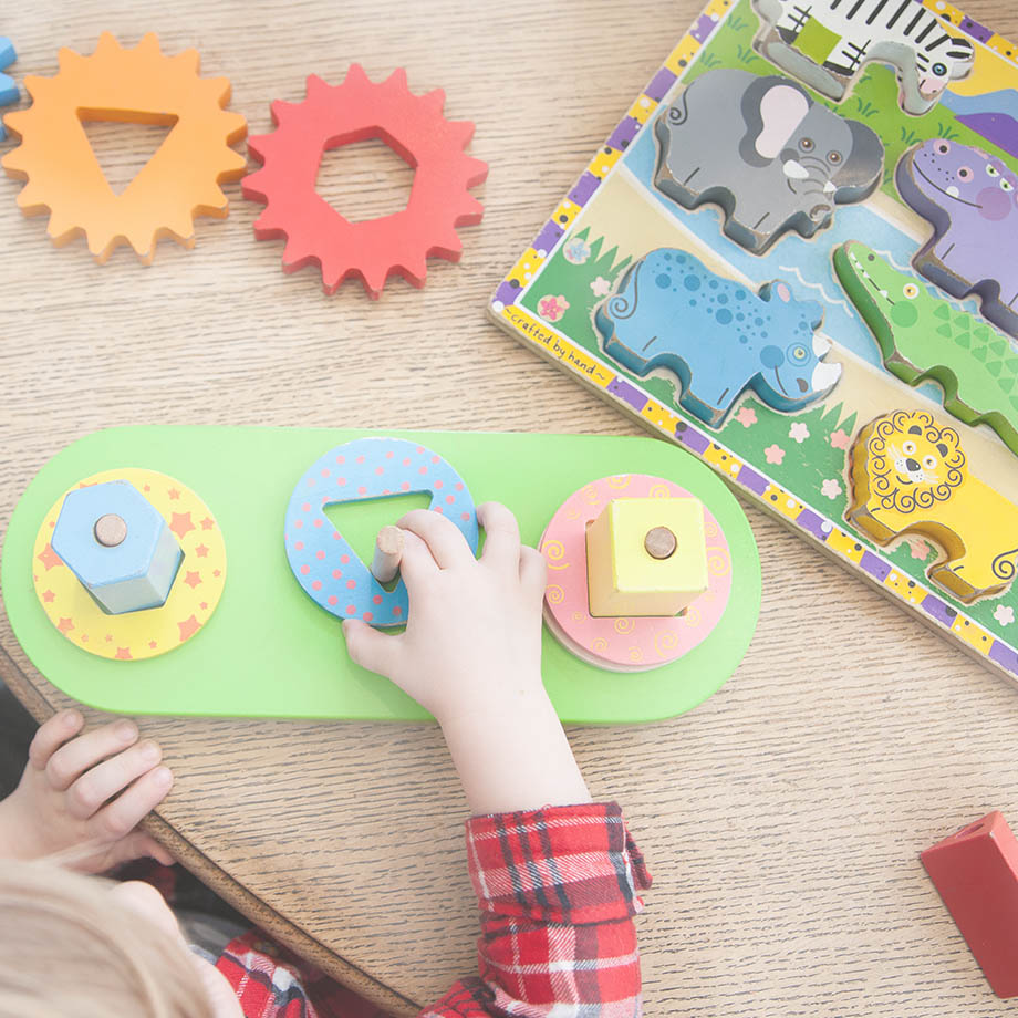baby with blocks and puzzles as a unique baby gift