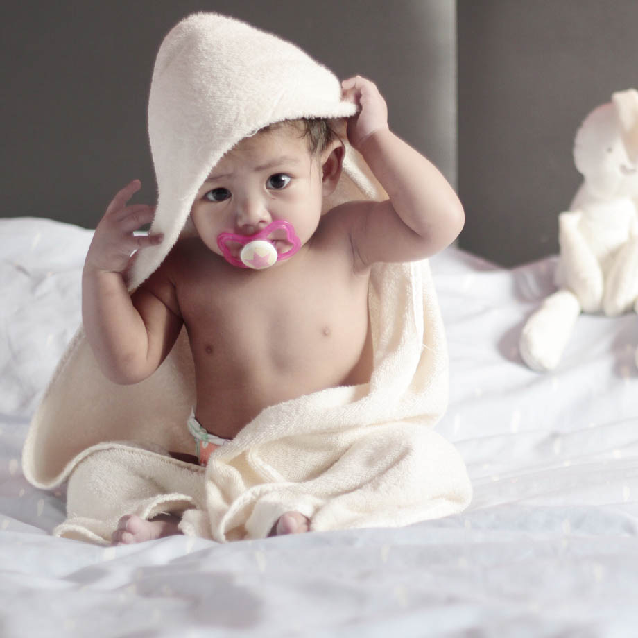baby with pacifier as a unique baby gift